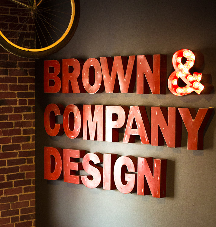 Brown & Company Design lettering on the wall of our office